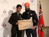 MPP Singh presents an award to Anujan Raveenthiran