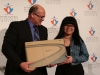 Mayor Thompson presents an award to Caryl Chua