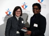 Sheila McWatters presents an award to Abhishek Moturu