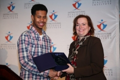 Mustafa-Ahmed-receives-Emerging-Young-Leaders-Award-from-Hon.-Tracey-MacCharles