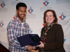Mustafa Ahmed receives Emerging Young Leaders Award from Hon. Tracey MacCharles